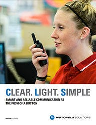 A young women wearing a red shirt using a Motorola CLS Series two-way radio to communicate